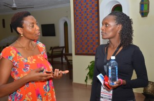 Mary Wanjau with a client